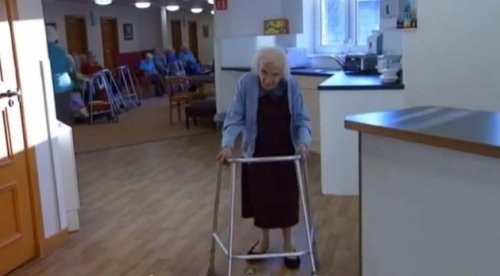 Jessie spends her days walking around her care home and chatting to other residents and staff (STV/YouTube)